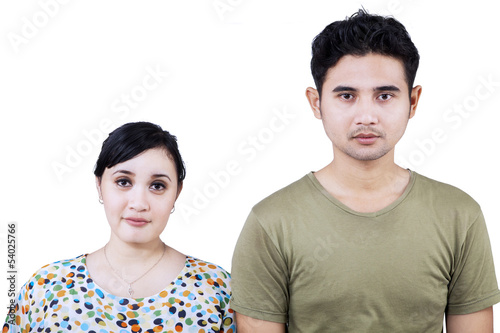 Asian couple looking at camera - isolated