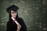Attractive nerd graduate at classroom