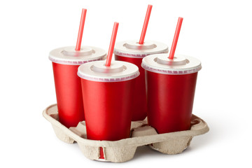 Four red takeout cups in a cup holder
