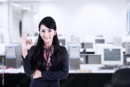 Businesswoman approval gesture at office