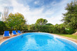 Luxury summer swimming pool with sun loungers. For relaxation an