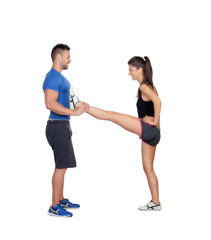 Gym women exercising with her personal trainer