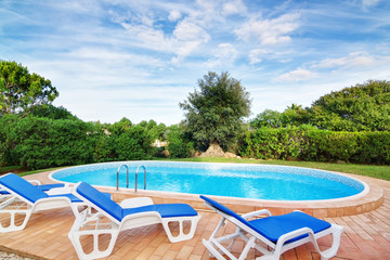 Luxury swimming pool with sun loungers. For relaxation and swimm