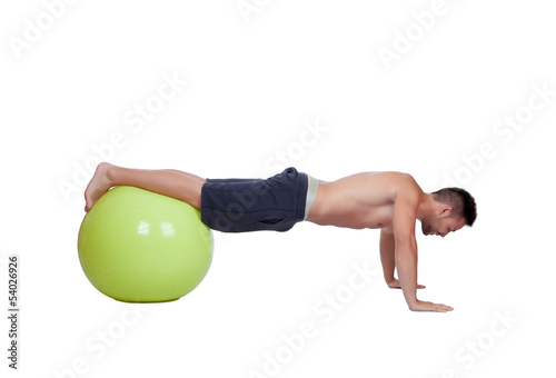 Strong man practicing pushups with a big ball