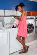 Woman Putting Clothes in Washing Machine