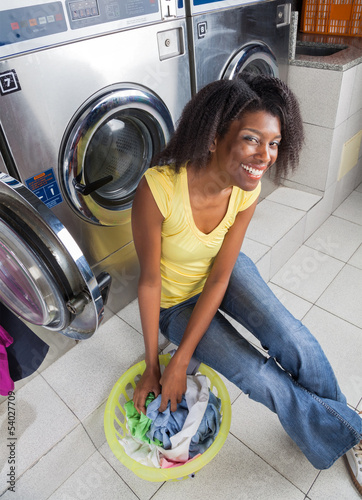 Young Woman With Laundry Basket