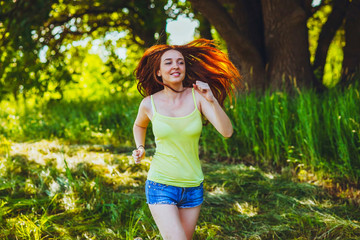 Young Brunette Woman runner running outdoors, the prospect of a