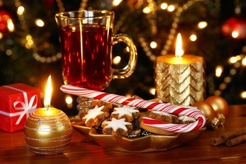Christmas cookies and candy cane with tea
