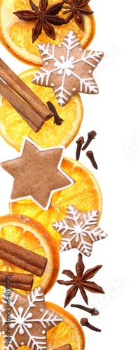 Dry orange slices, spices and Christmas gingerbread cookies.
