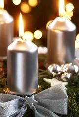 Detail of advent wreath on dark background.