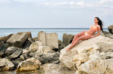 Beautiful brunette woman enjoying her time on the beach
