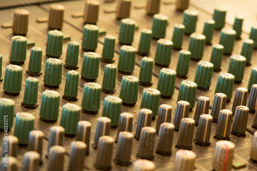 Close up of audio mixer with shallow depth of field