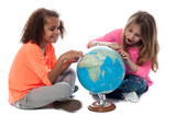 Young girls locating countries on globe