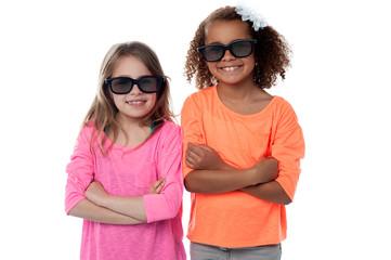 Two little girls in black sunglasses