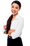 Beautiful young businesswoman, arms folded