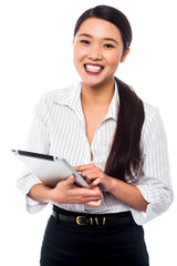 Corporate woman browsing on tablet pc