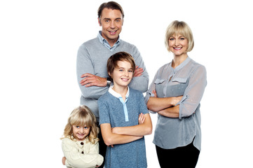 Happy family posing with arms crossed