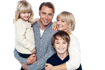 A happy family with children in studio