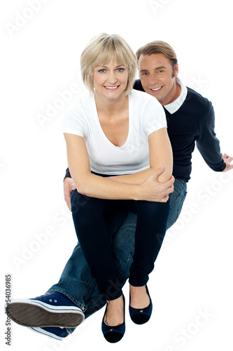 Middle aged lady sitting on her man's lap
