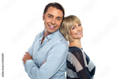 Cheerful couple leaning on each other