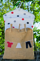 Clothes peg bag on the washing line