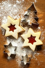 Christmas cookies with jam and cookie cutters