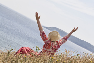 Woman with hands raised toward heaven