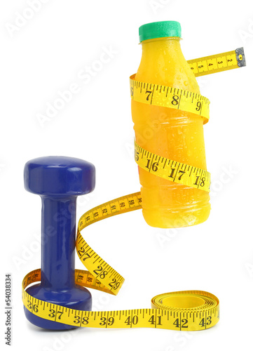 Orange juice with measuring tape and dumbbell