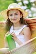 Hammock, garden - girl with a book resting in hammock