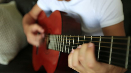 young boy playing guitar 3