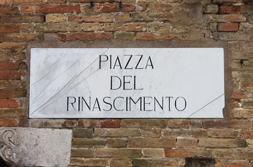 Medieval street sign in Urbino, Italy