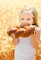 Cute little girl eating bread