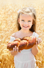 Happy girl on field of wheat