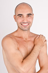 Athletic bald man laughing posing with the arm on the shoulder