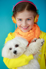 Young girl with cute puppy