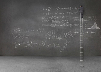Businessman standing on a giant ladder and writing maths equatio