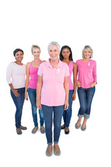 Diverse group of happy women wearing pink tops and breast cancer