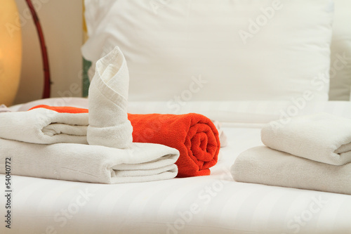 Towels on bed at luxury hote