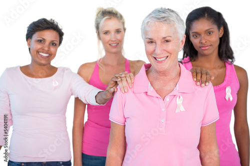 Supportive group of women wearing pink tops and breast cancer ri