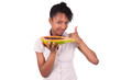 Young happy black / african american woman holding fresh papaya