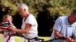 Grandchildren and grandparents riding bike