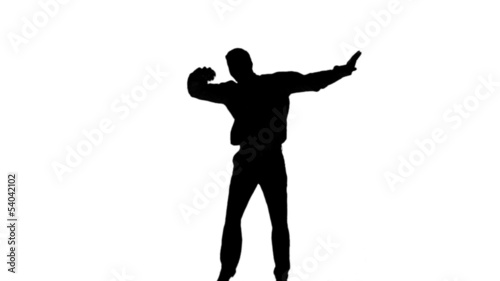 Silhouette of a man jumping and raising legs on white background