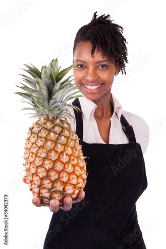 Young happy black / african american woman holding a fresh melon