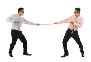 Two Asian businessmen pulling a rope