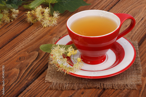 Herbal tea with a linden on a napkin in a rustic style