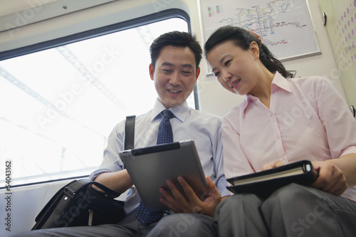 business couple working in the subway