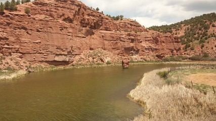 River curving past eroded rocky cliffs