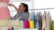 Pretty fashion designer measuring a dress