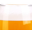 Beer glass close up. Froth. Background.