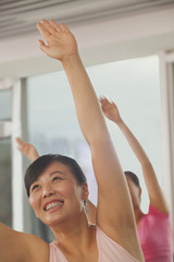 Mature women exercising in the gym
